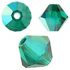 Swarovski Crystal Bicone. Emerald AB Color. 4mm. Approx. 144 PCS. 5328