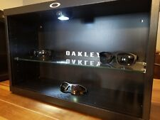 Oakley LED display case stand for shades and sunglasses fits up to 14 shades.