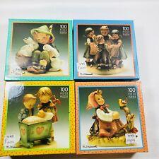 M.J. Hummel set of 4 New in Box M.I. Hummel 100 Piece Puzzle's