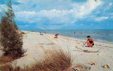 SANIBEL & CAPTIVA ISLANDS FLORIDA SHELLING & SWIMMING ON BEACH POSTCARD 1960s