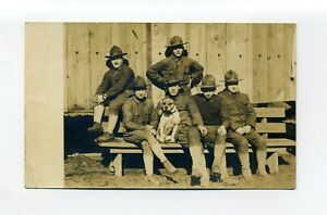 Antique military RPPC photo postcard, 1918 to 1930, soldiers with dog