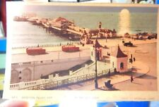 Brighton palace pier by day and night hold to light; VV penso