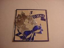 Vintage NOS Pkg 5 Embossed CHRISTMAS Seals:Silver/Blue Foil Holly w/Bow