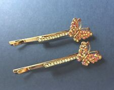 A pair of sparkly crystal hair pins -  gold tone butterfly