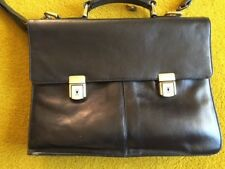 Soft black leather briefcase with two front pockets in excellent condition