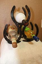 Horseshoe pyramid wine rack holds three bottles