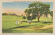 Man Putting Golf Ball in Roanoke, Virginia - Country Club House from Golf Course