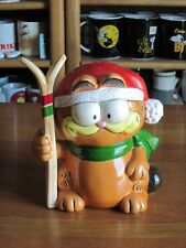 "GARFIELD BANK WITH SKI ENESCO CERAMIC 7"" TALL"