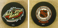 LOT OF 2 HOCKEY PUCKS - NHL OFFICIAL IN GLAS CO - MINNESOTA 2004 ALL-STAR GAME