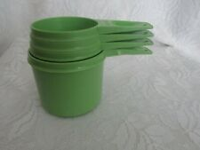 Four Vintage Tupperware Green Measuring Cups