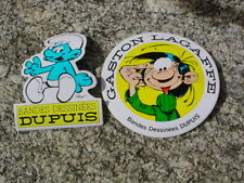edition dupuis lot de deux autocollants :gaston + schtroumpfs  an 80/90