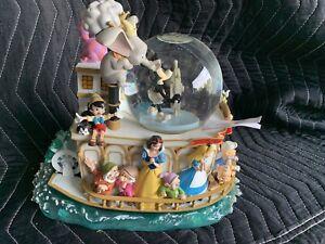 disney store snow globe (Mickey's 75th Anniversary Steamboat Ride)