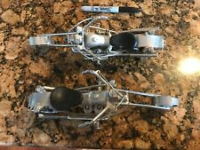 Two of a kind nuts and bolts retro motorcycles with rolling bearing wheels, move