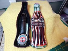 1997-COCA COLA COKE ADVERTISING LOGO WATCH WITH BOTTLE SHAPED METAL TIN