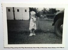 Vintage Black & White PHOTO Baby In Field With Hand Covering Mouth Next To Car