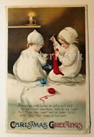 Vintage Ellen Clapsaddle postcard signed children stockings Christmas harvest