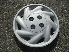 one genuine 1996 to 1999 Saturn S series bolt on 14 inch hubcap wheel cover