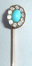 A VICTORIAN STICK PIN SET WITH TURQUOISE & PASTE STONES IN GOLD TONE METAL