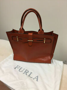 Furla Terracotta Color Leather hand bag.
