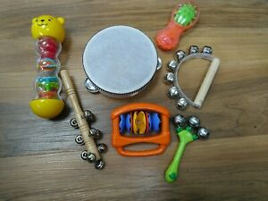 7 toy musical instruments, rainstick, bells, shaker tamourine