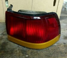 FORD ESCORT TAIL LIGHT 4-DOOR PASSENGER SIDE w/BULBS OEM 1994-1996