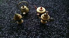 BRONZED ORNAMENTS, SET OF FOUR: different shaped antique teapot ornaments