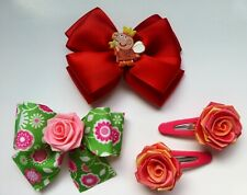 Set of 2 new Hair Bows, 1 features Peppa Pig, Clips on back, plus 2 barrettes!