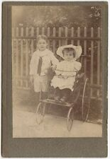 YOUNG CHILDREN WITH VINTAGE WHEEL CHAIR BY MCKEOGH, NY, CABINET CARD