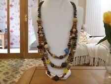 Brand new long  statement necklace with three strands of wooden beads