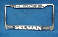 VINTAGE LICENSE PLATE FRAME SELMAN CHEVROLET CHEVY ORANGE CA CALIFORNIA CAMARO