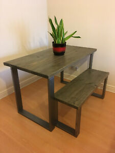 Industrial dining table in reclaimed timber with raw steel frames