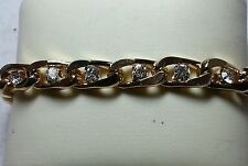 Jackie Kennedy Gold-Toned Bracelet with simulated diamonds in the center JBK