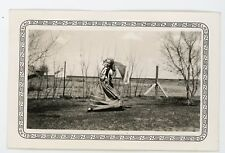 Girl in rural setting dancing in gypsy costume.  Vintage snapshot photo