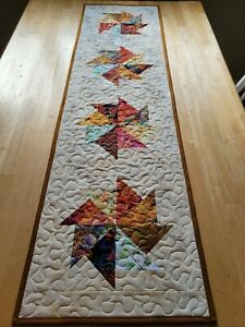 Handmade quilted table runner multi-colored with pinwheels