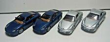 Four Porsche 2 Blue Carrara S & 2 Silver Cayman HO