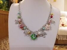 Brand new silver butterfly necklace with multi coloured glass flowers and pearls