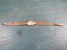 ancienne montre femme mécanique or 18K. Tête d' Aigle ELGE SUISSE