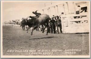 1940s SHERIDAN RODEO, Wyoming RPPC Postcard Bull Riding Scene Doubleday Photo