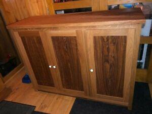 A SHOE cupboard made from solid Tiger Stripe Oak.