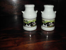 ceramic milk can with cow sean on front salt and pepper shaker
