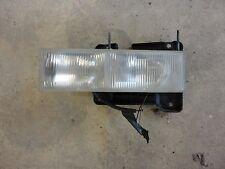 1998-2002 GMC Sierra 1500 left lh driver headlight head light with bracket