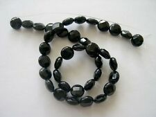 Black onyx faceted coin beads 10mm. Black onyx beads.