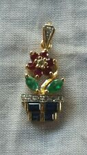 14kt.yellow gold sapphire,ruby,emerald and diamond flower pot pendant