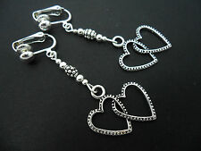 A PAIR OF DANGLY TIBETAN SILVER  DOUBLE TWO  HEARTS  CLIP ON EARRINGS.  NEW.