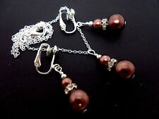 A BROWN GLASS  PEARL   NECKLACE AND CLIP ON  EARRING SET. NEW.