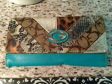 Ladies wallet:trifold, animal print/ metallic material, snap closure good cond.