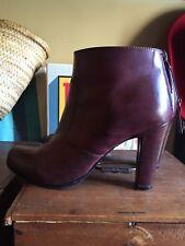 Low boots cuir prune zip arrière André 38