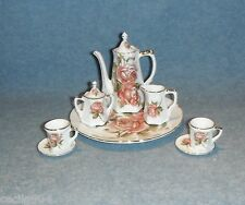 10 PIECE PINK AND RED ROSE PORCELAIN MINIATURE TEA SET WITH PLATTER