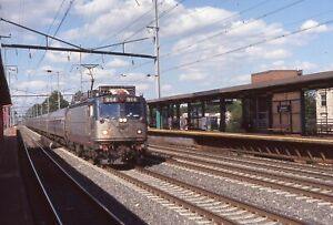 AMTRAK 2010 slide. AEM7 917 with Keystone train. Elizabeth, NJ. Acela livery