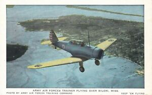 OLD VINTAGE BILOXI MS POSTCARD ARMY AIR FORCES TRAINER FLYING OVER BILOXI